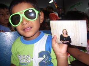 boy with sunglasses and photo